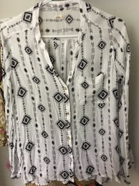 White and black floral button-up sleeveless shirt Brownstown, 48193