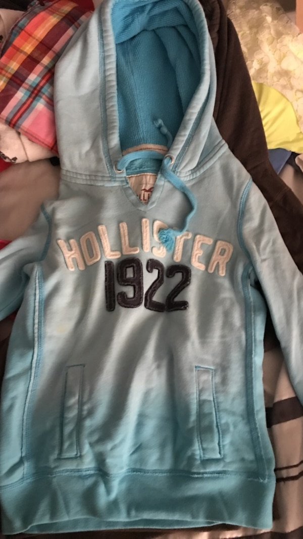 blue and white Hollister hooded jacket