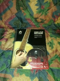 This teaches how to play guitar with cd its brand  Estancia, 87016