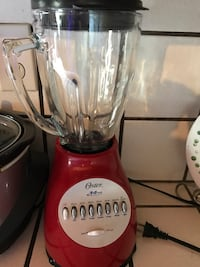 red and gray Oster blender