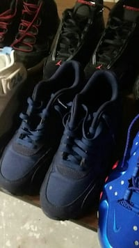 pair of black-and-blue running shoes