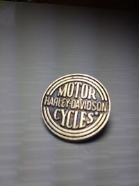 round silver-colored Harley-Davidson button pin
