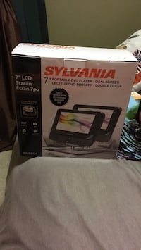 """Sylvania 7"""" dual screen DVD player for car - uses only twice  Surrey, V3W"""