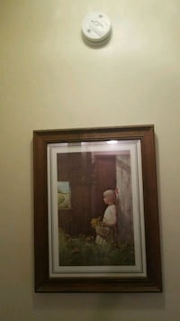 girl leaning on wall painting with brown wooden frame Dixon, 61021