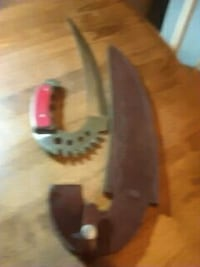 Knife and leather sheathed