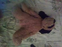 brown and black dog plush toy
