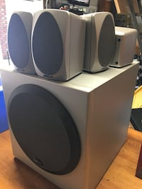grey and white 5.1 channel speakers
