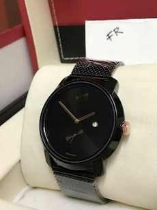 round black Movado chronograph watch with black straps