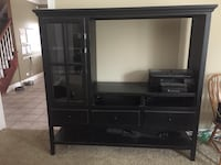 Black media cabinet. Solid wood. Good condition. Slight scratch on shelf where tv sat. Pick up only. Berlin, 10961