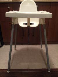 white and black wooden high chair