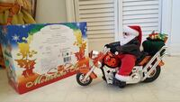 Santa Claus ride on cruiser motorcycle decor with box Kissimmee, 34747