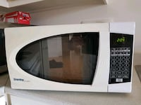 white and black microwave oven Dollard-des-Ormeaux, H9G