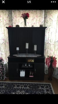 black wooden TV stand with flat screen television Herndon, 20171