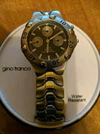round black Gina Franco chronograph watch with silver-colored link band 554 km