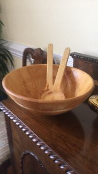 Wooden salad bowl with serving spoon and fork
