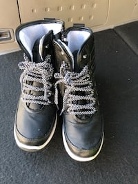 Pair of black leather high top sneakers