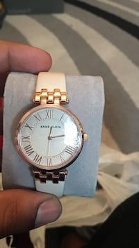 round gold Michael Kors analog watch with link bracelet