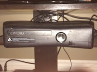 Black xbox 360 game console with game cases and head set Welland, L3C