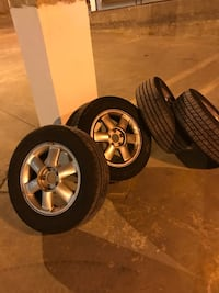 four silver-colored 6-spoke vehicle wheel and tire set 236 mi