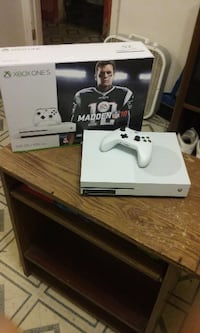 white Xbox One console with controller and box