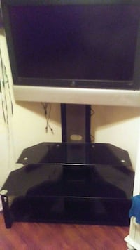 """Glass entertainment center w/ 37"""" Tv mounted"""