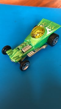 Green and black ride on toy car