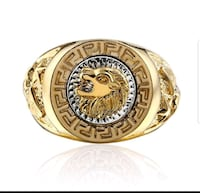 round gold and silver lion head ring