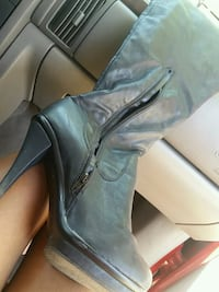 pair of black leather heeled booties Fresno, 93704