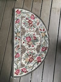 White, red, and green floral textile