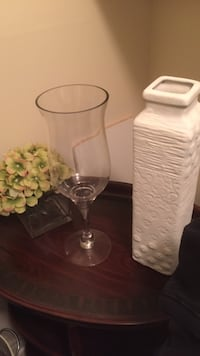 clear wine glass and white ceramic vase