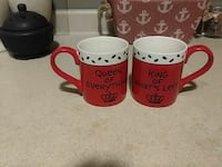 two red-and-white King and Queen ceramic mugs
