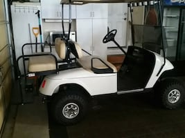 Ezgo Electric Golf Cart with lift