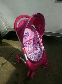 baby's pink and white floral car seat carrier Warren