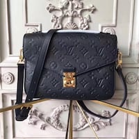 Louis Vuitton black cross body bag  Toronto, M1V 3Z3