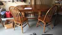 Wooden oak 2 Pedestal table with 6 chairs & 2 leafs
