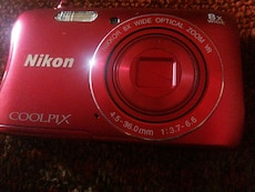 red Nikon Coolpix point and shoot camera