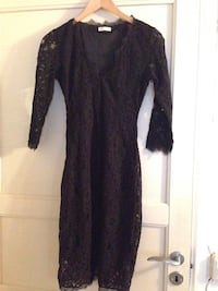 Lace dress. Bought new but washed and unused