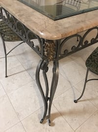 Rectangular rod iron glass top dining room table with 4 rod iron chairs...mint condition
