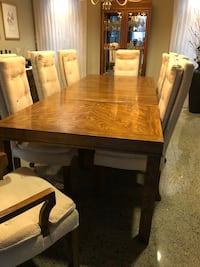 Rectangular brown wooden dining table and 8 dining chairs table has 2 insert or leaves incl 3741 km