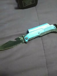 teal and gray folding knife 987 mi