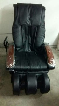 Like NEW reclining leather massage chair. Price DROP negotiable