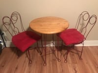 round brown wooden table with two chairs Des Moines, 50310