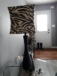 black and white zebra-pattern lampshade table lamp