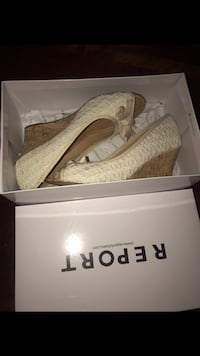 pair of beige Report peep-toe wedge sandals with box
