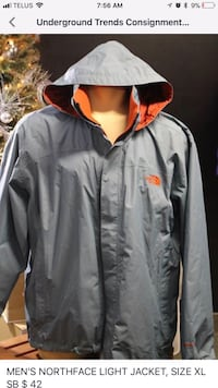gray and orange The North Face hoodie jacket