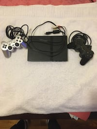 One PS2 Console With Two Controls.