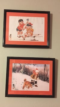 Two black wooden framed painting of boy and dog paintings Dallas, 75231