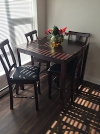 rectangular black wooden table with four chairs dining set Port Coquitlam, V3B