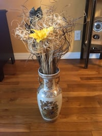 clear glass vase with yellow petaled flowers SYOSSET