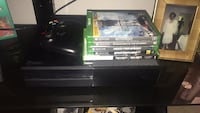 black Sony PS3 Super Slim with game cases 922 mi